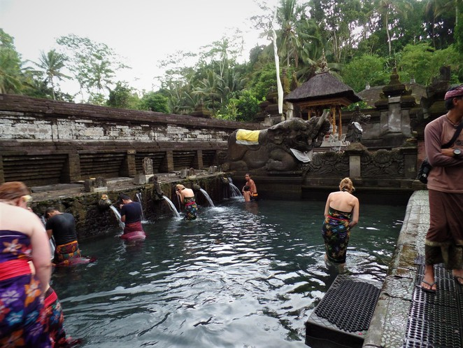 cleansing ritual at Tirta Empul Temple in ubud bali