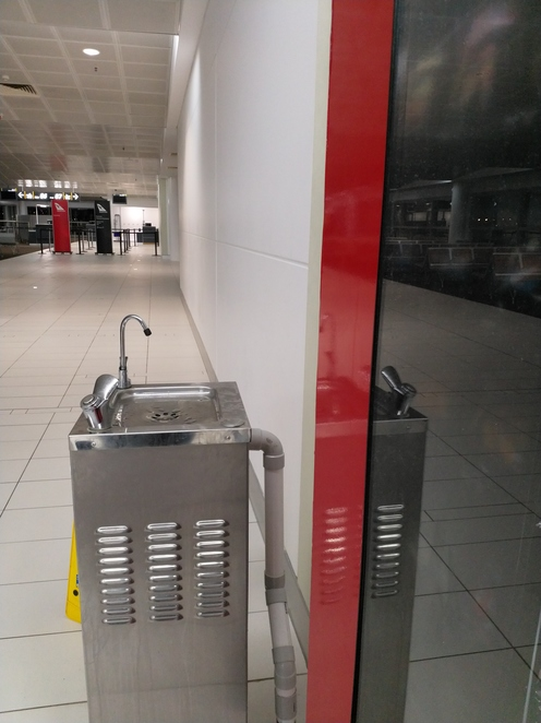 This water fountain near Gate 86 on Level 3 was the only one my bottle would fit under. It's a bit of a hike, but good exercise.