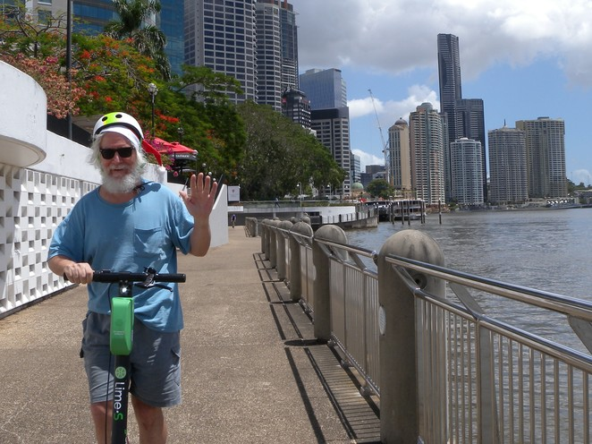 Santa on Lime, with views of Brisbane and river in the background.