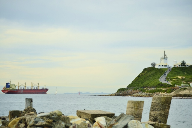 nobbys headland, newcastle, newcastle harbour, coal ship