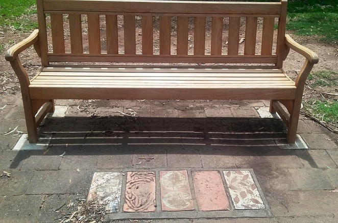 Tiles in the park bench