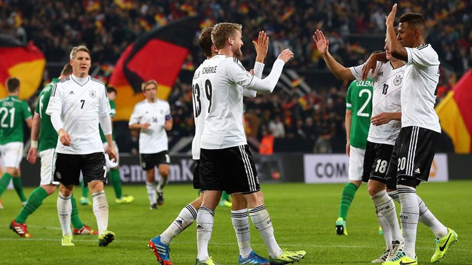 Andre Schuerrle (C) of Germany celebrate with his team mates