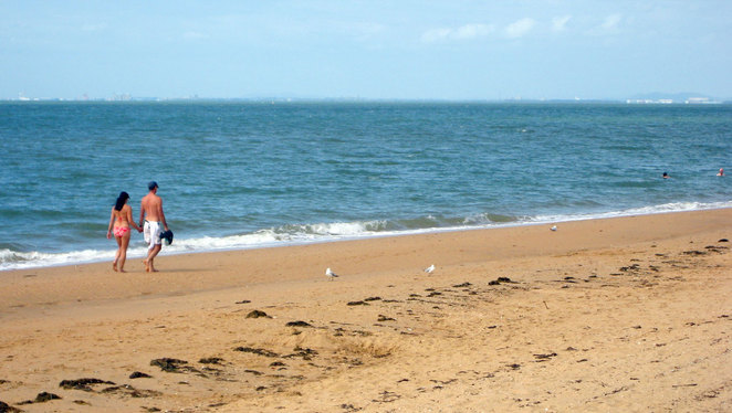 Couple walking on the beach on the Redcliffe Peninsular