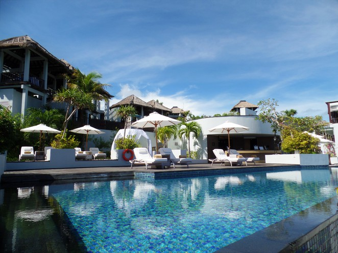 crystal blue restaurant & pool at Samabe Bali Suites & Villas