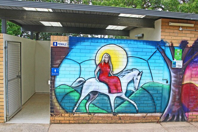 Lady on horse mural.