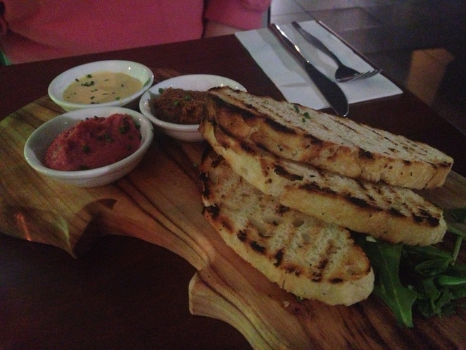 The trio of dips with grilled ciabatta toast ($10.90)