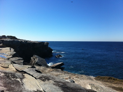 Cape Solander is surrounded by water and sandstone cliffs