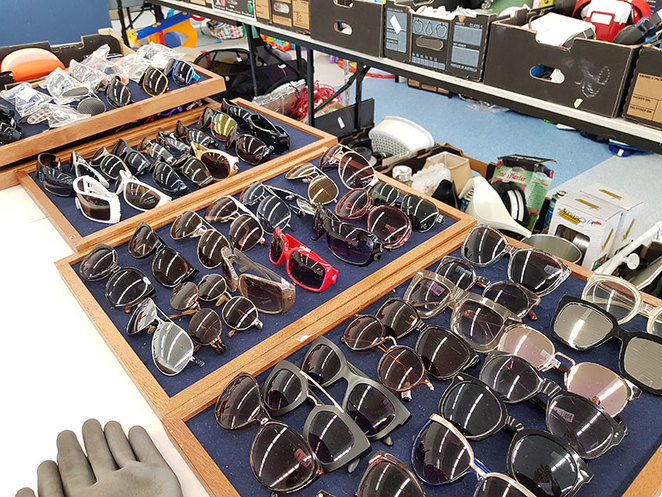 Scroungers Massive Winter Garage Sale 2018 table of sunglasses at Paraquad