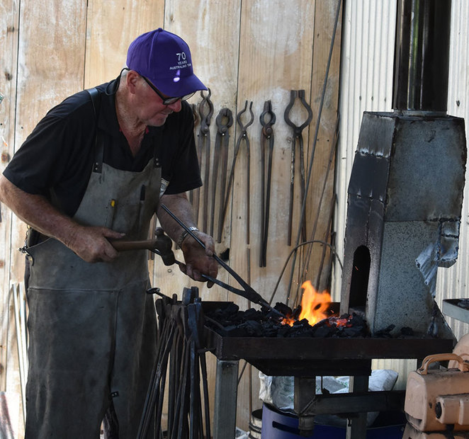 Blacksmith Blast at the South West Rail and Heritage Centre. Brian Golding, a member of the Boyanup Foundation Blacksmiths hard at work in the Blacksmith's forge at the South West Rail and Heritage Centre (Photographer: Lorelei Giorgi).