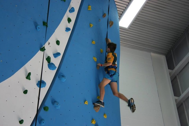 Indoor Rock Climbing, for anyone over the age of five, $11 per person, expend surplus energy, fun for the whole family, get your mountaineer on