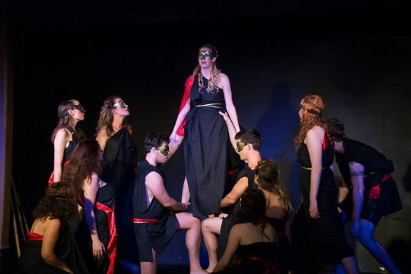 students acting greek chorus performance show