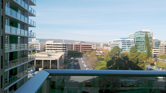 Our hotel view to the Adelaide Hills shows the wide streets and low city profile.