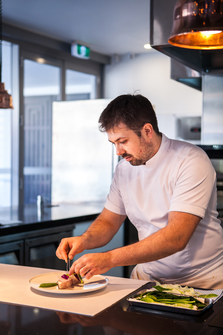 Chef Dan Arnold, where he is the most happy, in the Kitchen