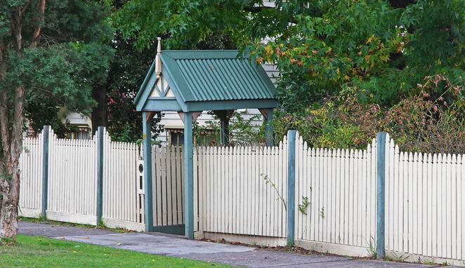Lych gate & picket fence.