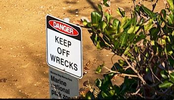 Guyundah_wreck, keep_off, woody point sign
