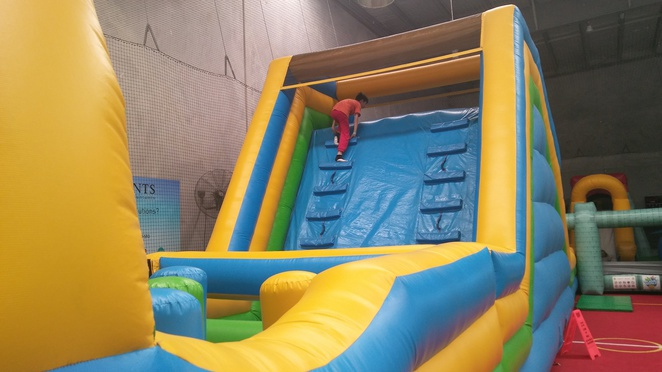 inflatable world, slide, obstacle course