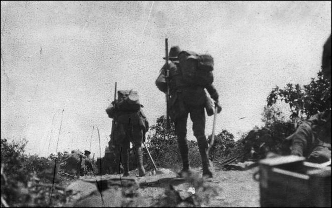 Australian troops going into action across Plugge's Plateau after the landing