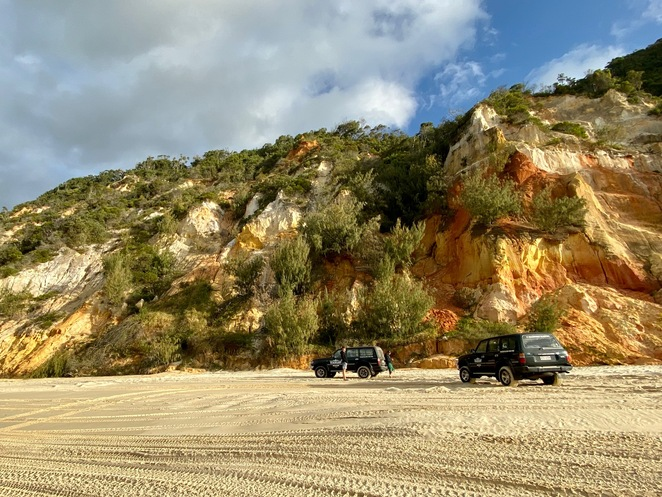 Driving along the coloured sands of Rainbow Beach is a beautiful way to start your K'Gari adventure!