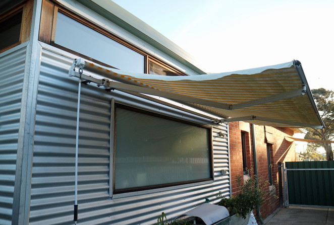 sustainable house day awnings