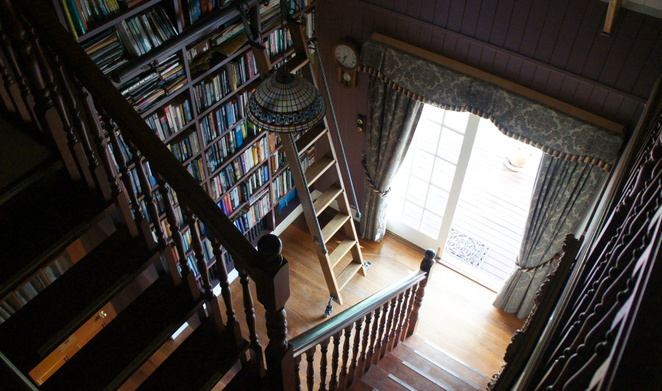 The library leads up to the entertainment space in the attic