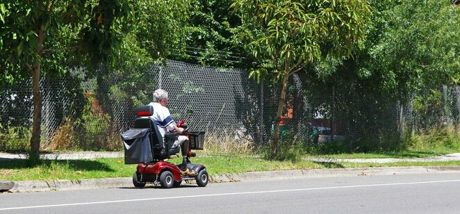 man on scooter.