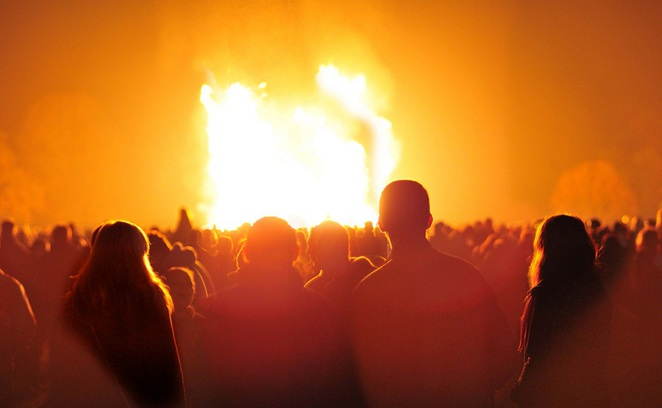 Spectators gather around a bonfire at Himley Hall near Dudley