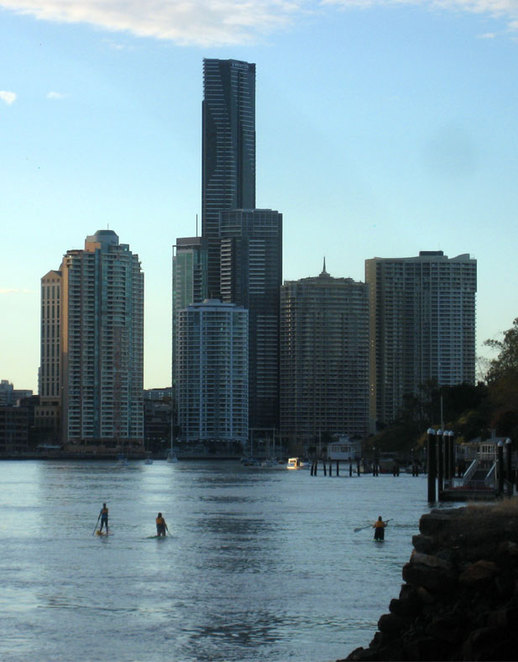 Stand up paddler boarders and kayakers on the Brisbane River