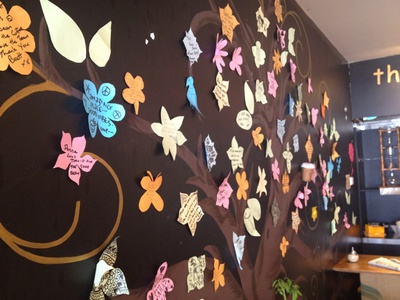 One of the walls is covered with positive messages from customers and friends of the cafe