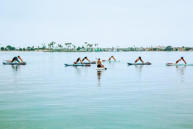 stand up paddle board, yoga, manly , nye