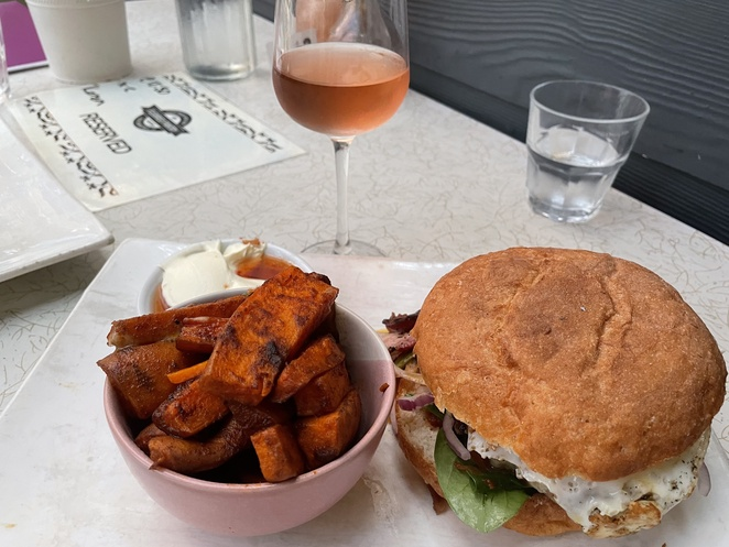 'The Worx' burger with sweet potato wedges