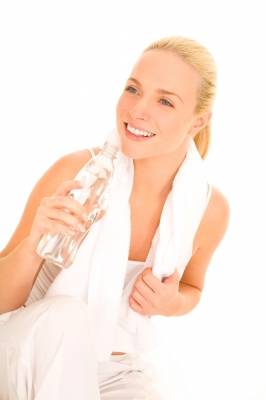 Woman Holding Bottle with Towel