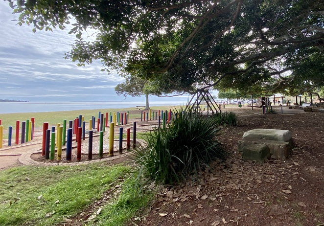 Looking across the playground at Wellington Point Recreation Reserve to Moreton Bay