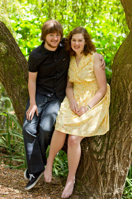 park photo shoot photograph couple tree green dress
