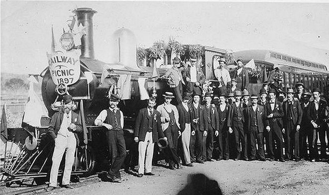 Railway Picnic: A group of well-dressed fellows posing in front of the G Class loco at Spencer's Brook in 1897. The locomotive is decorated in honour of the railway picnic. Photograph courtesy of the Rail Heritage WA Archives. The Old-Fashioned Railway Picnic Day at the South West Rail and Heritage Centre