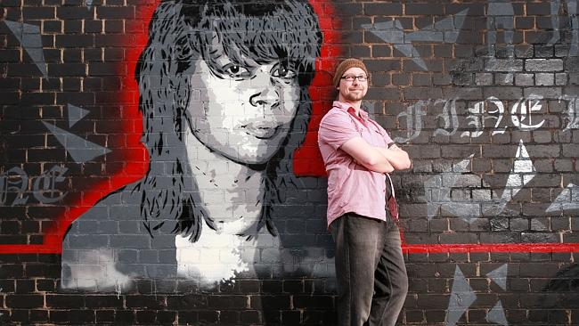 Glen Smith with his mural of Chrissy Amphlett