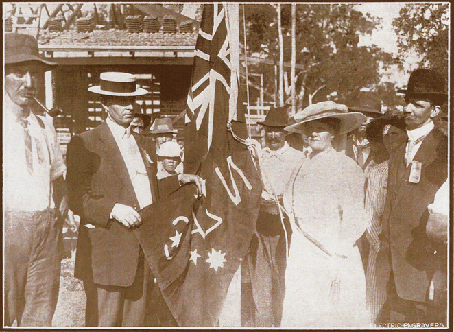 The 'Soldier's Queen', Mrs. Charles Roberts, hoisting the unique ANZAC flag at the Cottage at approximately 5.00pm on February 12, 1916.