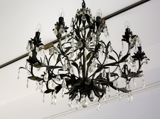 The mock chandeliers are stylish and there is art on the walls