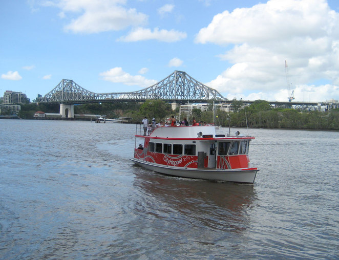 The free little red ferry makes it way past the Story Bridge