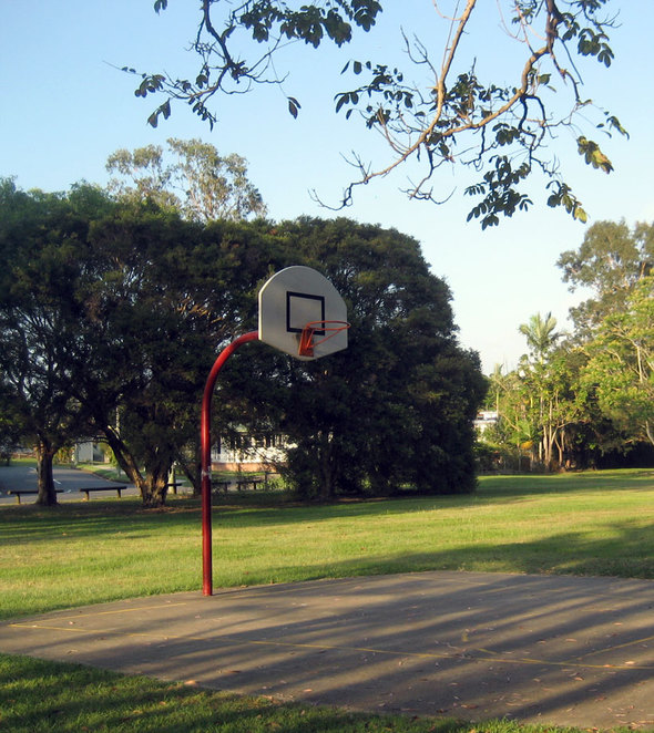 A basketball half-court in a park