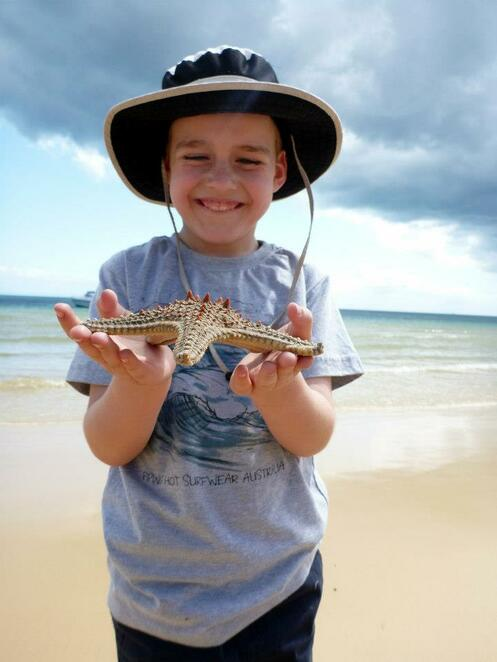 Rescuing a starfish that was stranded by the tide