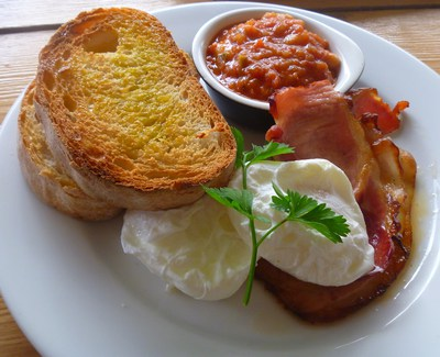 Poached eggs, bacon, beans and chorizo at The Stranded Store