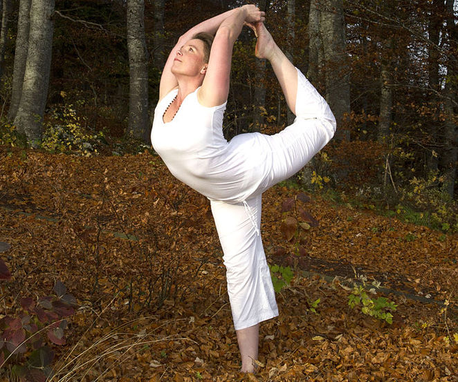 Yoga is a great way to achieve health and fitness naturally. This image is from Wikimedia Commons (by jfbongarcon).