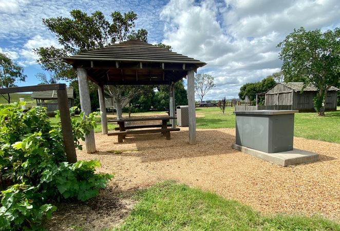 The memorial park includes picnic tables and a gas BBQ