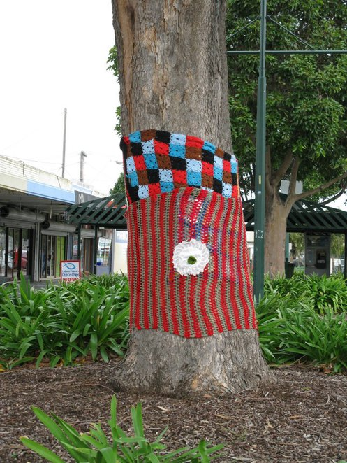 A tree trunk in Geelong, Yarn Bombing wrapped around the trunk