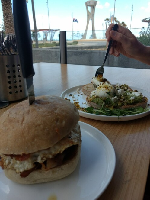 Bacon and Egg Roll with Beef Patty and Avocado Smash with Feta, Dukkha and Poached Eggs @ Monty's Cafe