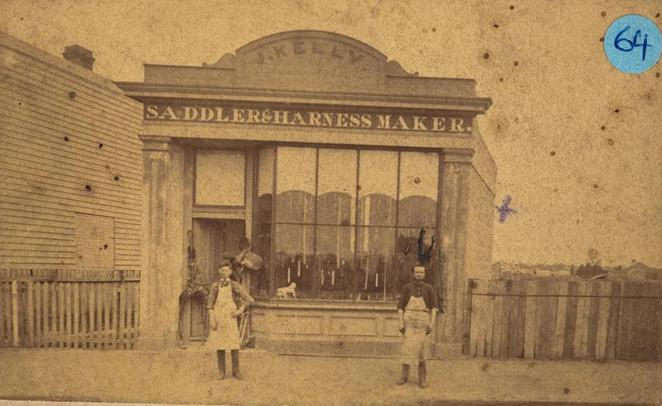 Staff photograph of owner and staff member standing outside J Kelly Saddler and Harness Maker