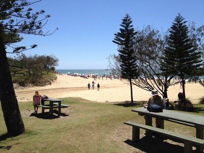 A couple of picnic tables within earshot of the beach