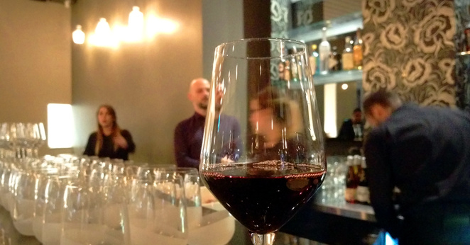 Enjoy wine at the bar before the meal