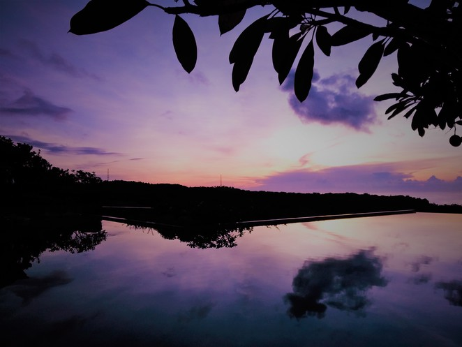 sunrise over infinity pool in banyan tree ungasan bali