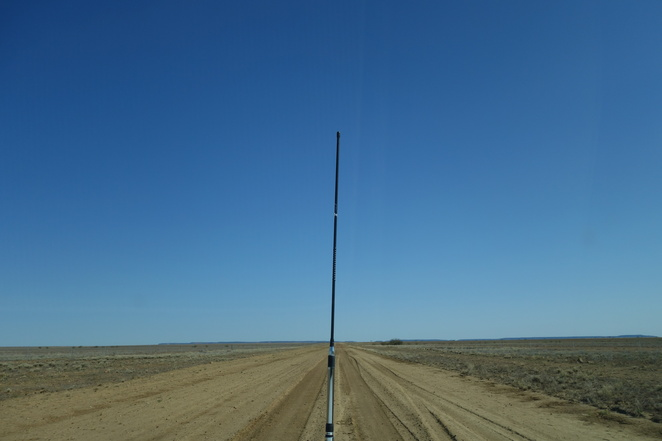 aerial,car,outback,queensland,empty,road,dusty,dry,plains